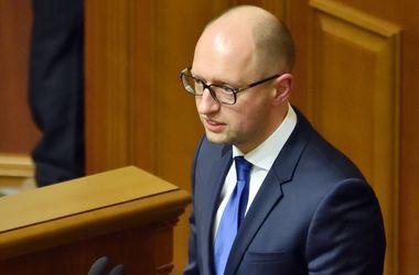 <p>Яценюк в Раде озвучил размеры экономический потерь. Фото: AFP</p>