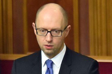 Яценюк просит больше денег у МВФ