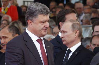 Порошенко потребовал от Путина выполнения минских договоренностей