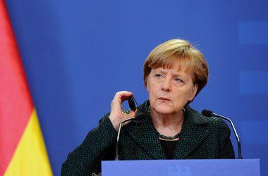 В Кремле не знают, какой мирный план привезут Олланд и Меркель