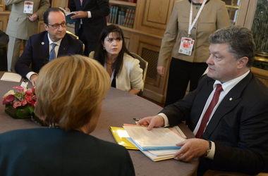 Что стоит за визитом Меркель и Олланда в Киев: заморозка конфликта и новая линия разграничения на Донбассе