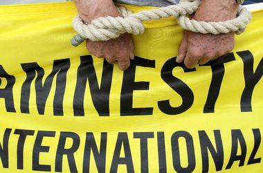 Amnesty International: Пытки и убийства пленников в Донбассе - военное преступление