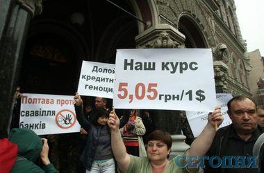 Рада предварительно обязала банки реструктуризовать валютные кредиты украинцев
