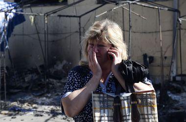 Жители Донецка читают псалмы, развешивают в подъездах молитвы и верят в счастливый случай