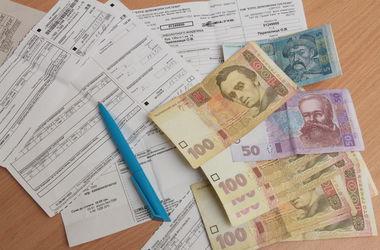 За какую сумму долга по коммуналке могут отобрать квартиру и как платят украинцы (инфографика)