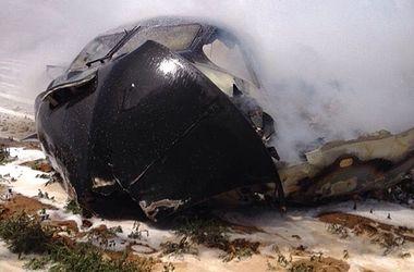 Самолет в Севилье рухнул на завод Coca-Cola через минуту после взлета