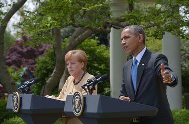 <p>Обама и Меркель сошлись во мнении относительно срока действия санкций против России.Фото: AFP</p>