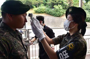 Люди в масках. Смертоносный вирус опустошил улицы и вызвал панику в Южной Корее