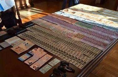 Во время обыска в Апелляционном суде нашли много денег и оружие – СМИ