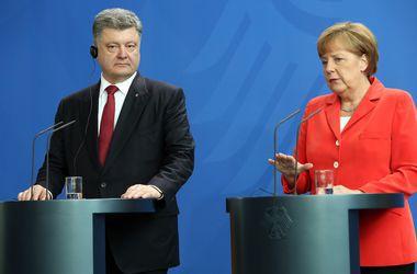 """Порошенко и Меркель провели телефонные переговоры накануне встречи """"нормандской четверки"""""""
