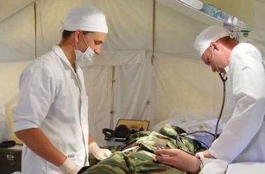 В Днепропетровск доставили 9 тяжелораненых бойцов