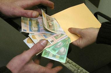 Под Киевом чиновника поймали на взятке в 10 тысяч гривен