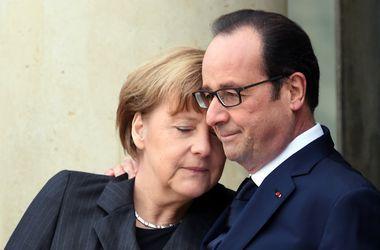 Меркель и Олланд перед встречей с Порошенко обсудят ситуацию с мигрантами