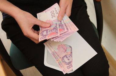 Кабмин предлагает установить единый налог на зарплату в размере 20%