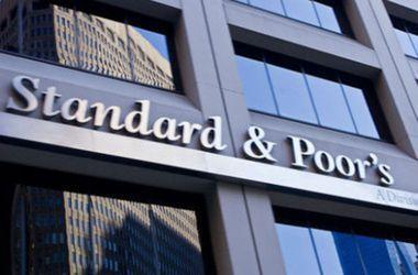 """S&P понизило рейтинг Украины до """"выборочного дефолта"""""""