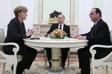 Олланд и Меркель по очереди поговорили с Путиным в Париже