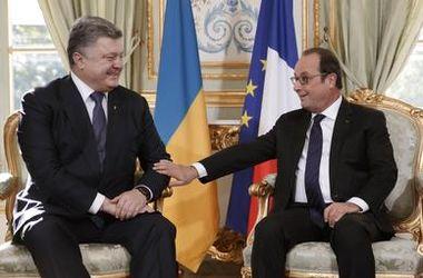 Пока Путин говорил с Меркель, Порошенко встретился с Олландом