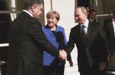 Меркель устроила рукопожатие Порошенко с Путиным в Париже
