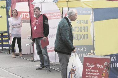 """Обещания от кандидатов в мэры: киевлян """"заманивают"""" дешевым жильем и льготным салом"""