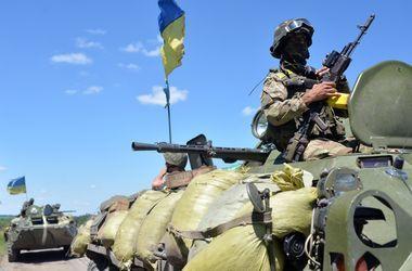 Военные отчитались об отводе вооружения на Донбассе