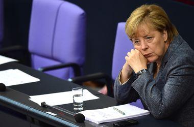 Меркель предложила поделить беженцев