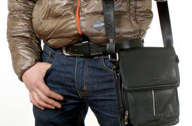 В Николаеве у бизнесмена со стрельбой отобрали сумку с деньгами