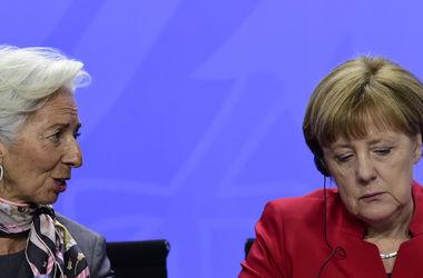 Лагард и Меркель потребовали решительной борьбы с коррупцией в Украине