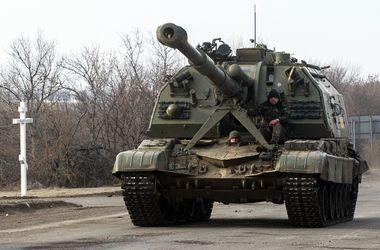 """ОБСЕ: В Луганске до сих пор стоят """"Грады"""", гаубицы и танки"""