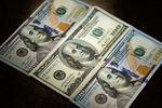 <p>НБУ за апрель запасся долларами. Фото: AFP</p>
