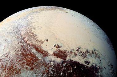 """NASA показало снимок """"разъеденной местности"""" Плутона"""