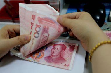 Китай вновь резко девальвировал юань
