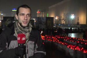 На Майдане люди выложили из лампадок большой тризуб