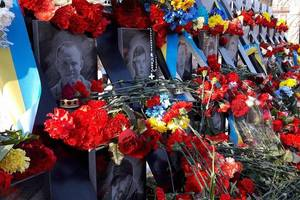 The anniversary of the Maidan, laying flowers at the memorial service for the victims