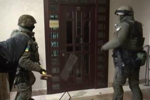 Подробности обыска у команды Черновецкого: полицейские изъяли более миллиона гривен