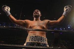 Americký boxer obvinil šampion WBC Уайлдера bití