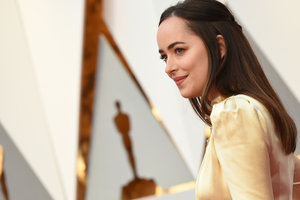 Dakota Johnson, Jessica Biel, and Emma stone opted for Oscars gold dresses