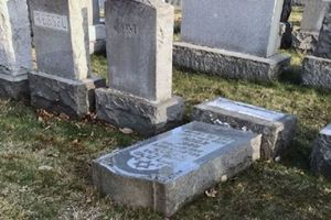 In the US vandals damaged more than 100 gravestones at Jewish cemetery