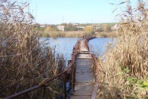 Мост ушел под воду в Днепропетровской области