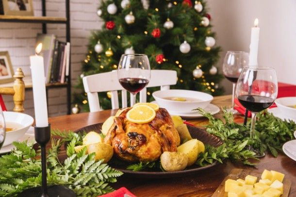 christmas-dinner-with-turkey-and-glasses-of-wine_23-2147716324