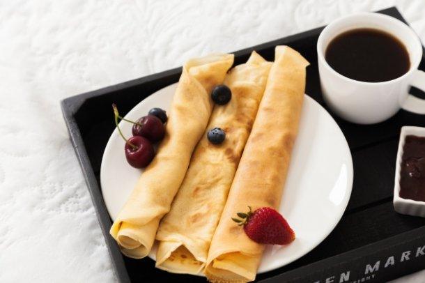 fresh-pancakes-with-fruits-and-coffee_23-2147666229
