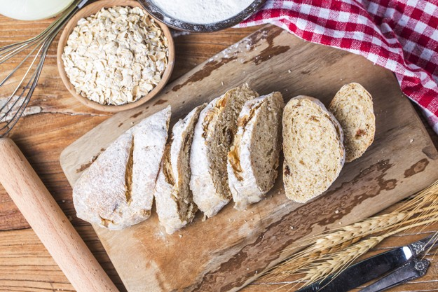 freshly-baked-traditional-bread-on-wooden-table-oatmeal-bread_1205-2072