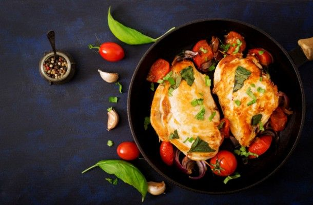 grilled-chicken-breast-stuffed-with-tomatoes-garlic-and-basil-in-pan-top-view_2829-701