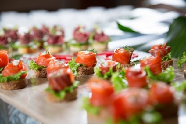 mini-canapes-with-smoked-salmon-on-buffet-table_1262-1873