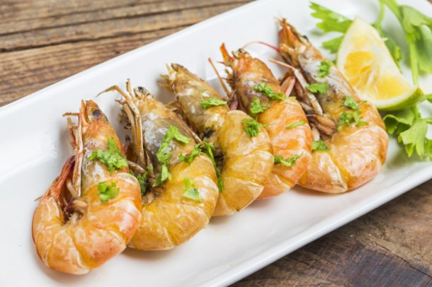 row-of-prawns-decorated-with-herbs_1205-24
