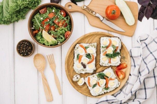 salad-tartines-and-cutting-board_23-2147694428