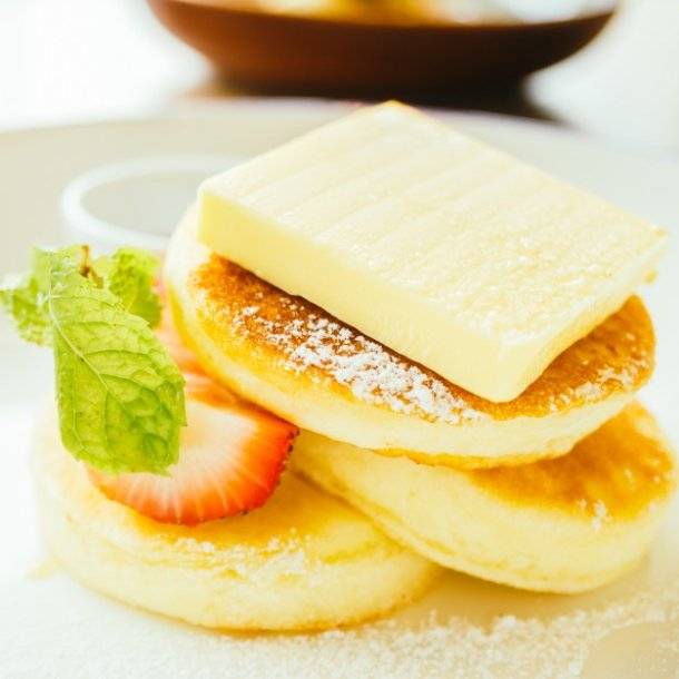 sweet-dessert-pancake-with-butter-and-strawberry_1203-9427