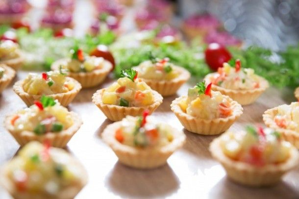 tartlets-with-vegetable-salad-on-buffet-table_1262-2037