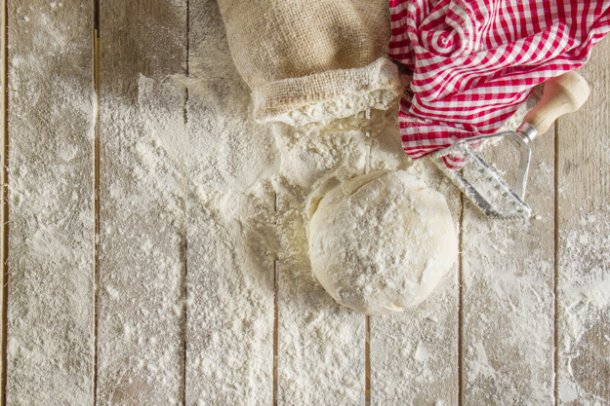 top-view-of-wooden-boards-with-flour-and-dough_23-2147606584
