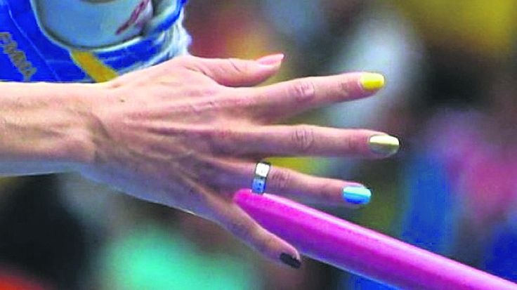 emma-green-tregaro-shows-her-multi-coloured-nails-in-the-high-jump-qualification-round-in-moscow-on-thursday-via-shutterstock-e1376752315724_6542401___01