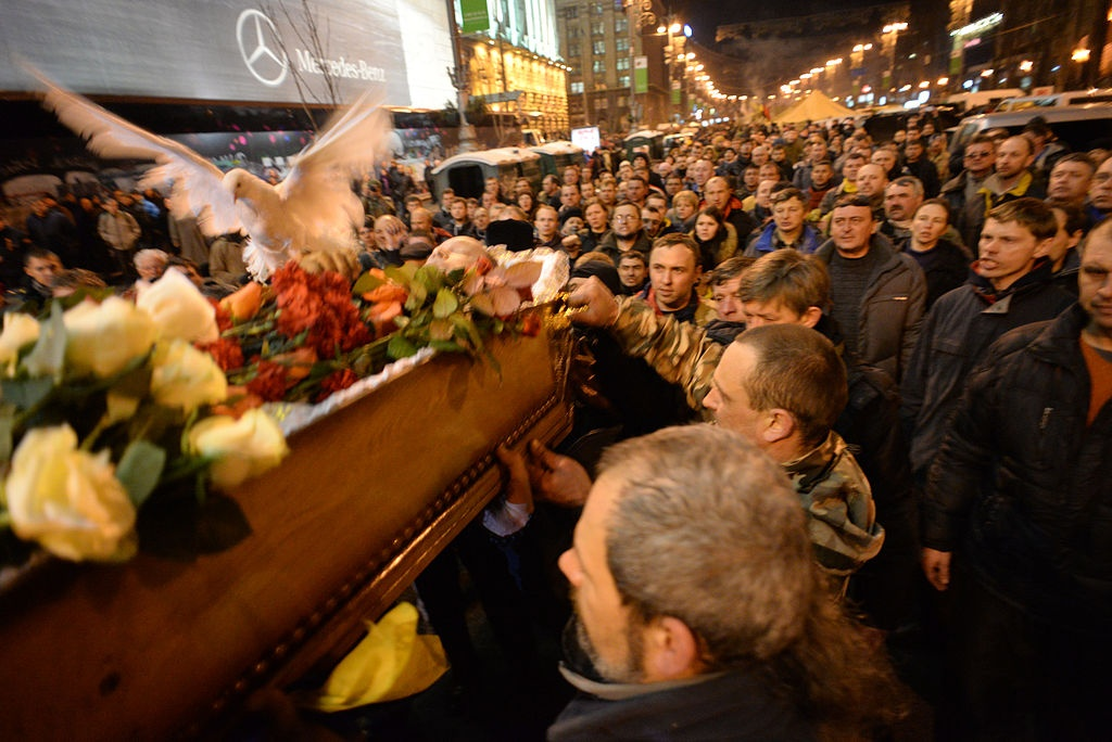 civil_funeral_of_one_of_the_protesters_killed_during_clashes_on_february_20._euromaidan_kyiv_ukraine_events_of_february_21_2014.